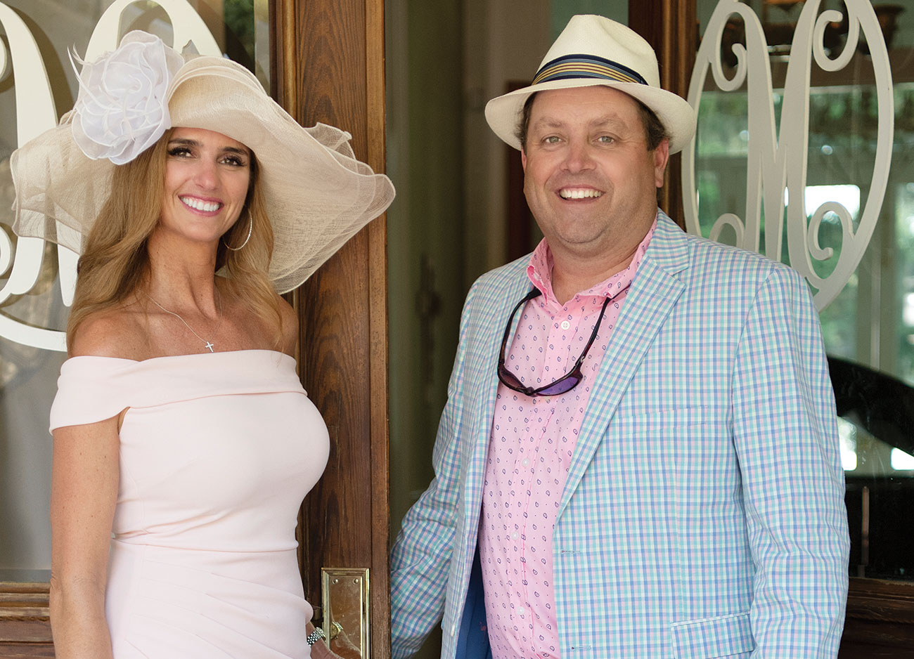Man and woman dressed in Kentucky Derby party attire