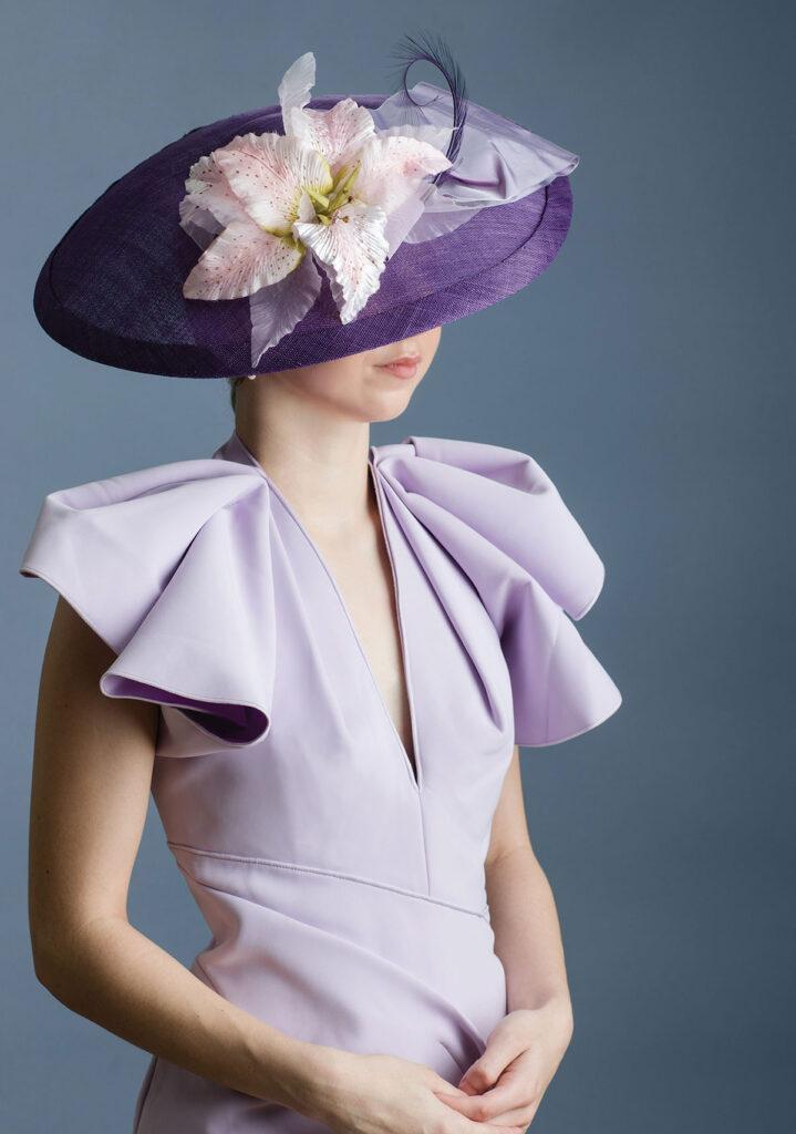 Lady wearing a Kentucky Derby-style hat