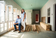 Man and woman standing at renovation site