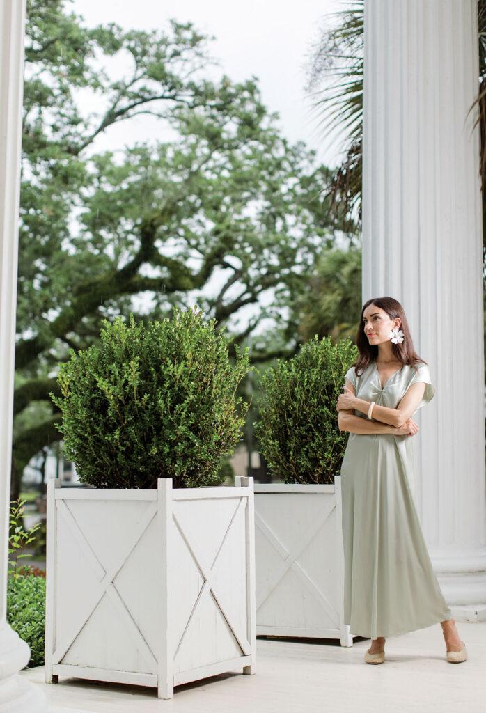 Elizabeth Damrich standing on her front porch