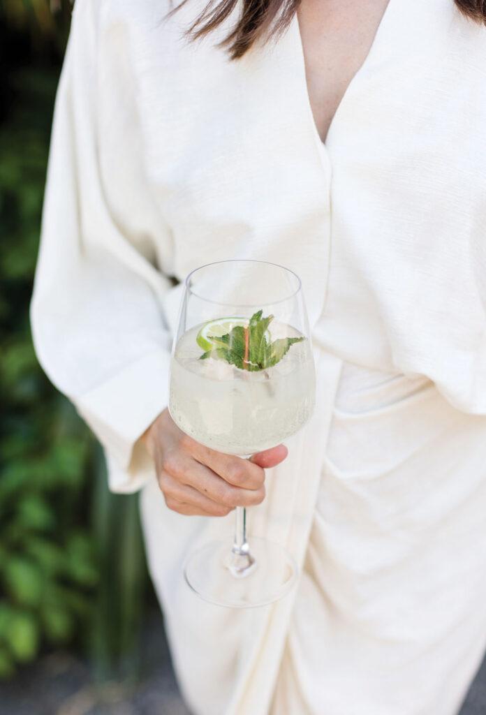 Close-up of Elizabeth Damrich holding a cocktail
