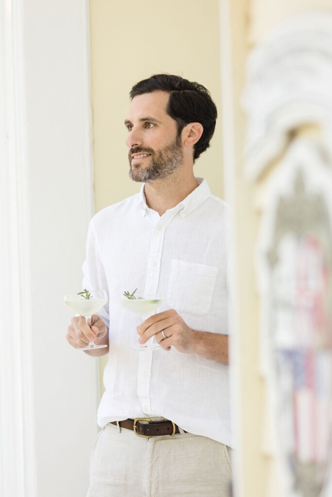 Man holding two cocktail glasses