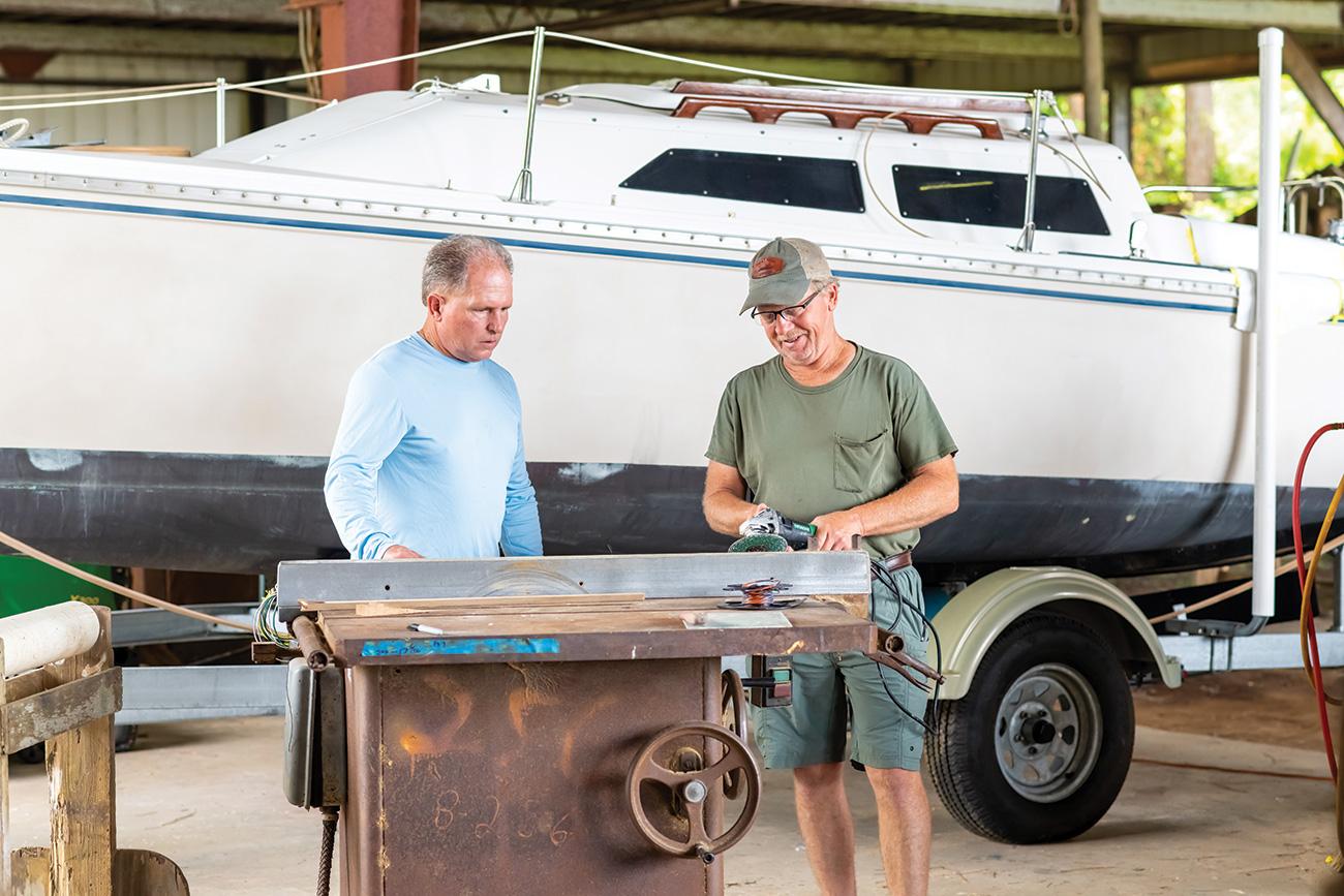 Two men working on a Resmondo boat