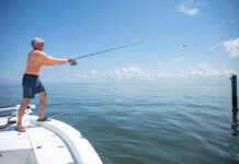 Man on a boat fishing for tripletail