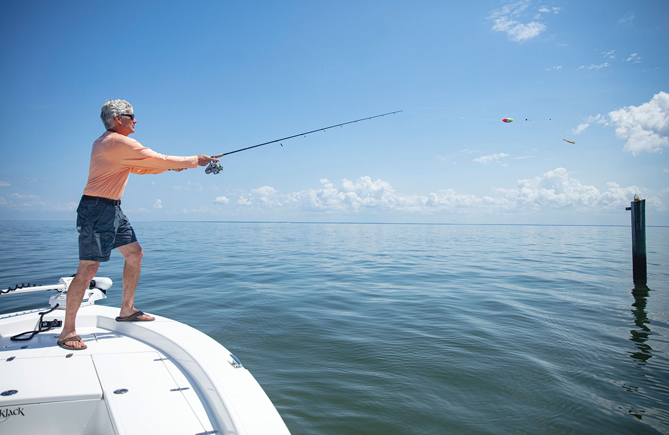 Man fishing for tripletail on a boat