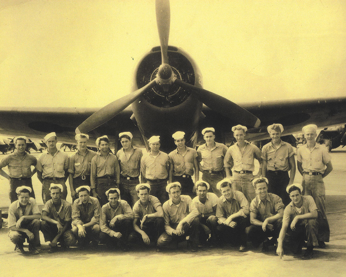 Airmen posing with plane at Brookley Army Air Field