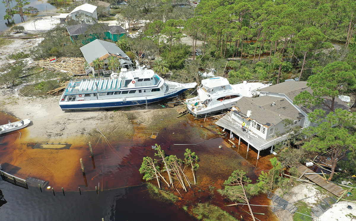 Wrecked boats beached on land from Hurricane Sally