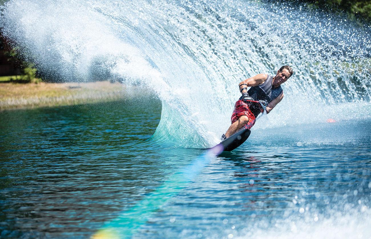 Man water skiing on a lake
