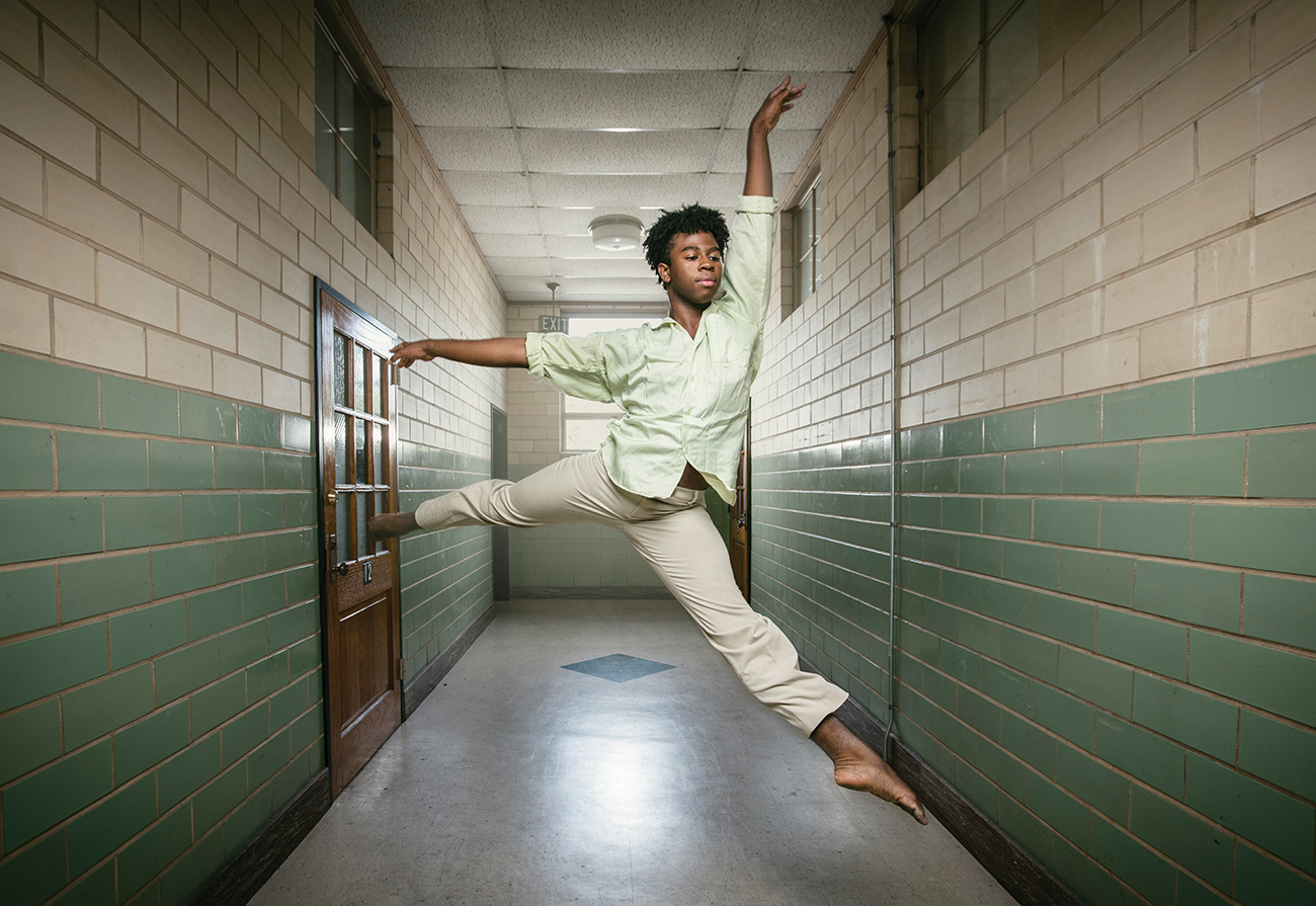 Dancer leaping in a hallway
