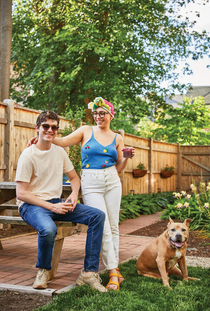 Lexi Mestas standing with her husband and dog