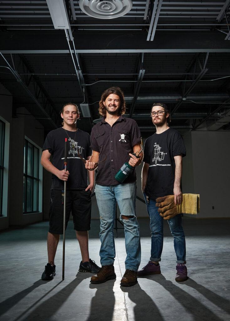 3 men of Muffinjaw Designs standing in warehouse