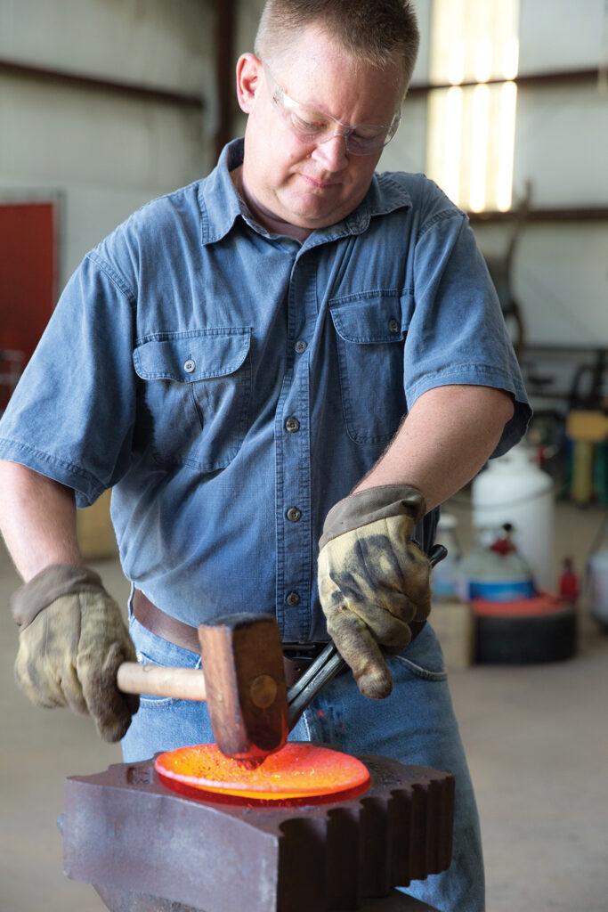 blacksmith at work in a workshop
