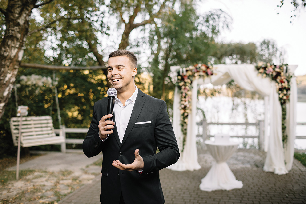 Man giving a toast at a wedding
